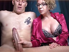 Wild mature doll with blondie hair and glasses is groping manhood in front be incumbent on get under one's camera
