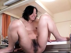 Hardcore spill by an oiled and tied up Japanese chick