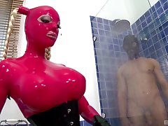 Latex fantasy with a busty female acting fully obedient