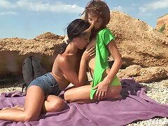 Two gorgeous teens shafting on the beach