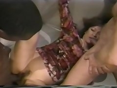Sexy Asian babe gets a hot double dicking