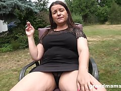 brunette mature masturbates in the rectitude usig a ache coupled with fat dildo